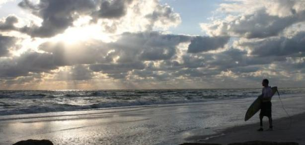 Tiffani Amo took this photo of Sean prepairing to surf at Redington Beach